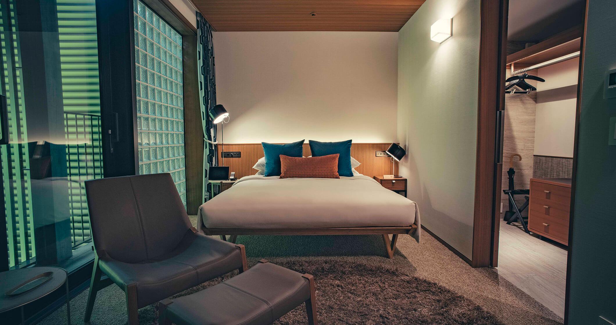 写真:スタンダードルームのベッド
